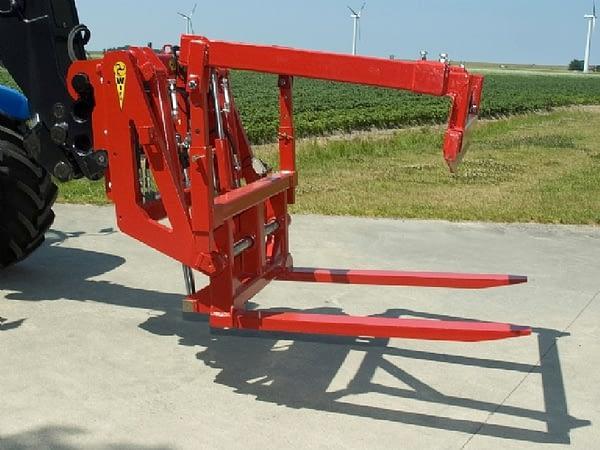 Forward box rotator for telescopic loaders
